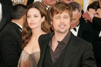 PAS 2 VITESH/ Angelina Jolie dhe Brad Pitt fotografohen së bashku (FOTO)